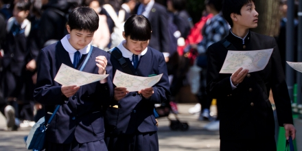Japanese high school students readings maps.